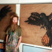 LOYALTY and COURAGE Spirit Bird Diptych artist-Darren Trebilco standing with the Diptych at the Solitude Art Gallery, 163 Glenview Road, Glenview, QLD AUST