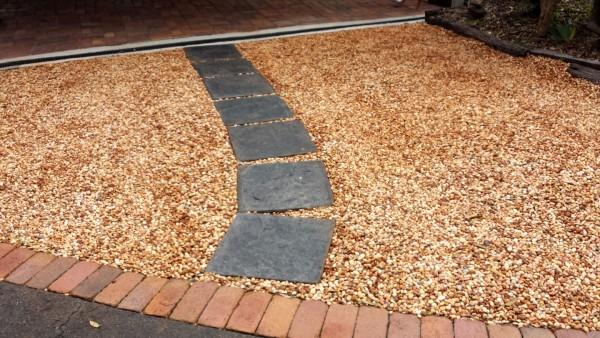 Western Red Pebbles layed down for phase 1 of the beautification of the Solitude Art Gallery and Open Studio